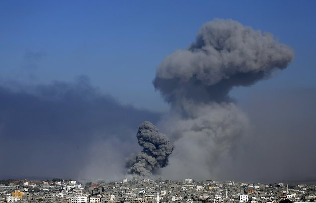 smoke-from-the-explosion-of-an-israeli-strike-rises-over-gaza-city-on-tuesday-july-29-2014-israel-escalated-its-military-campaign-against-hamas-on-tuesday-striking-symbols-of-the-groups-control-in-gaza-and-firing-tank-shells-that-shut-down-the-strips-only-power-plant-in-the-heaviest-bombardment-in-the-fighting-so-far
