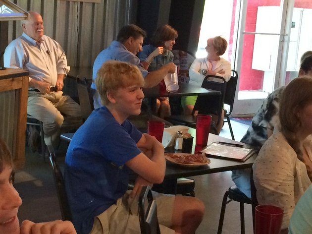 cooper-lair-a-16-year-old-little-rock-christian-academy-student-watches-himself-play-in-the-jeopardy-teen-tournament-semifinals-on-tuesday-at-his-watch-party-at-jims-razorback-pizza-in-west-little-rock