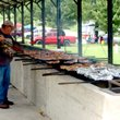 Photo by Mike Eckels The grill master stands watch over chicken halves Aug. 3, 2013, during the 60th Annual Decatur Barbecue at Veterans Park in Decatur.