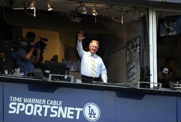 los-angeles-dodgers-broadcaster-vin-scully-shown-acknowledging-the-crowd-during-a-game-at-dodger-stadium-on-tuesday-will-return-for-a-66th-season-with-the-team-in-2015
