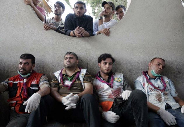 palestinian-medical-workers-take-a-break-wednesday-at-shifa-hospital-in-gaza-city-after-carrying-those-wounded-in-an-israeli-airstrike-on-a-market-in-the-shijaiyah-neighborhood