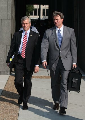 Former Virginia Gov. Bob McDonnell ( shown left) and his wife, Maureen McDonnell leave court Wednesday in Richmond after the day's proceedings.