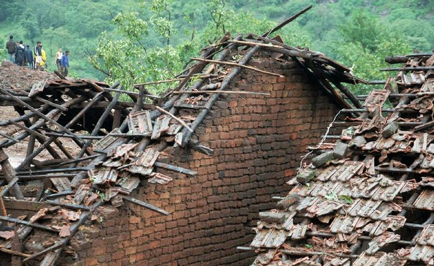 rescuers-arrive-at-a-damaged-house-wednesday-as-they-look-for-survivors-of-a-landslide-that-hit-malin-village-in-western-india