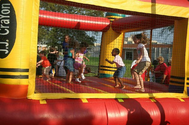 bounce-houses-are-a-key-part-of-the-fun-at-lamanpalooza-a-wholesome-family-friendly-celebration-presented-by-the-william-f-laman-public-library-system-this-years-event-will-be-at-the-newly-reopened-argenta-branch