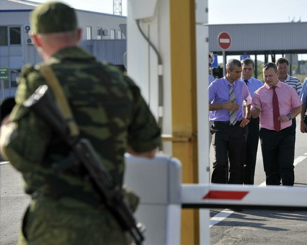 paul-picard-second-from-right-acting-chief-observer-for-the-organization-for-security-and-cooperation-in-europe-talks-to-other-members-of-the-organization-wednesday-while-visiting-a-checkpoint-at-the-russian-ukrainian-border-in-the-town-of-gukovo-russia