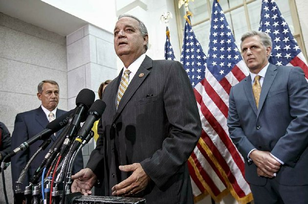 rep-jeff-miller-r-fla-shown-here-speaking-tuesday-on-capitol-hill-said-wednesday-that-the-house-was-addressing-the-biggest-scandal-in-the-history-of-veterans-affairs-also-shown-is-speaker-of-the-house-john-boehner-of-ohio-left-and-incoming-majority-leader-rep-kevin-mccarthy-r-calif-right