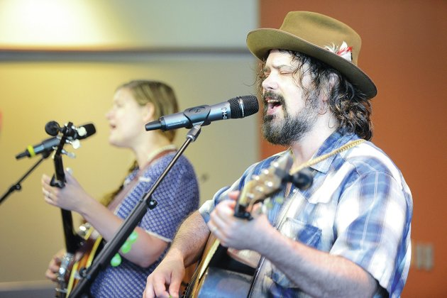 file-photo-cindy-woolf-left-and-mark-bilyeu-cq-of-springfield-mo-perform-sunday-july-13-at-the-fayetteville-public-library-during-the-mountain-street-stage-summer-music-series-woolf-and-bilyeu-will-return-to-fayetteville-to-perform-during-the-roots-festival-in-august-the-festival-will-be-aug-28-30