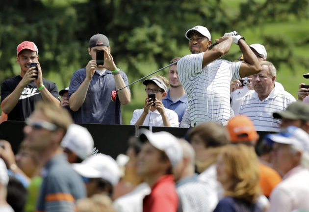 tiger-woods-watches-his-drive-on-the-third-hole-during-practice-for-the-bridgestone-invitational-golf-tournament-wednesday-july-30-2014-in-akron-ohio