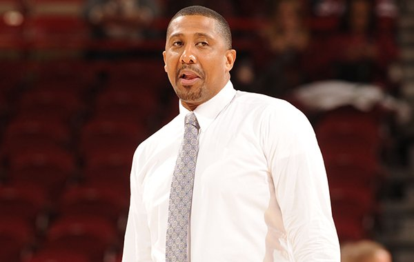 Scotty Thurman, director of student-athlete development for the Arkansas basketball team, watches as the Razorbacks warm up before playing Alabama Wednesday, Feb. 5, 2014, in Bud Walton Arena in Fayetteville.