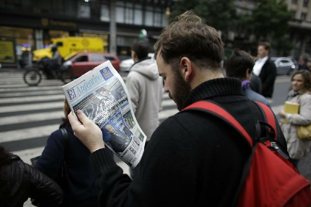 a-man-reads-a-newspaper-with-a-headline-that-reads-in-spanish-argentina-didnt-accept-the-conditions-of-the-vultures-in-reference-to-the-dispute-of-argentina-over-15-billion-with-a-us-hedge-fund-known-locally-as-vulture-funds-in-buenos-aires-argentina-thursday-july-31-2014-the-collapse-of-talks-with-us-creditors-sent-argentina-into-its-second-debt-default-in-13-years-and-raised-questions-about-what-comes-next-for-financial-markets-and-the-south-american-nations-staggering-economy-ap-photovictor-r-caivano