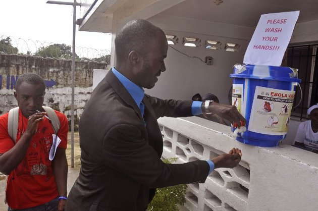 a-man-washes-his-hands-thursday-before-entering-a-public-building-in-monrovia-liberia-as-part-of-a-drive-to-prevent-further-spread-of-the-deadly-ebola-virus