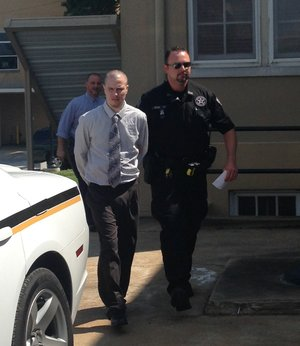 Zachary Holly is escorted Friday, Aug. 1, 2014, from court after learning prosecutors will be able to use his confession as evidence during his capital murder trial at the Benton County Courthouse in Bentonville.
