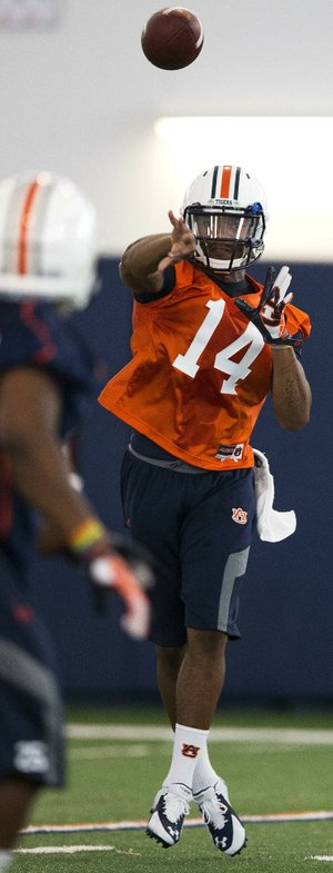 Auburn quarterback Nick Marshall (14) throws the ball during NCAA college football practice Friday, Aug. 1, 2014, in Auburn, Ala.