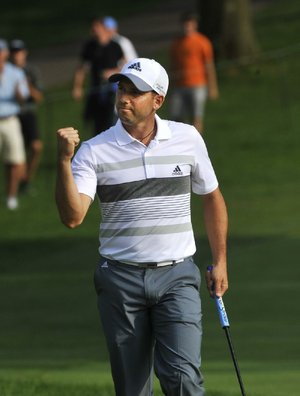 Sergio Garcia of Spain reacts after making a birdie at the 18th hole, during the second round of the Bridgestone Invitational golf tournament, Friday Aug. 1, 2014, in Akron, Ohio. Garcia shot a 61 for the day. (AP Photo/Phil Long)
