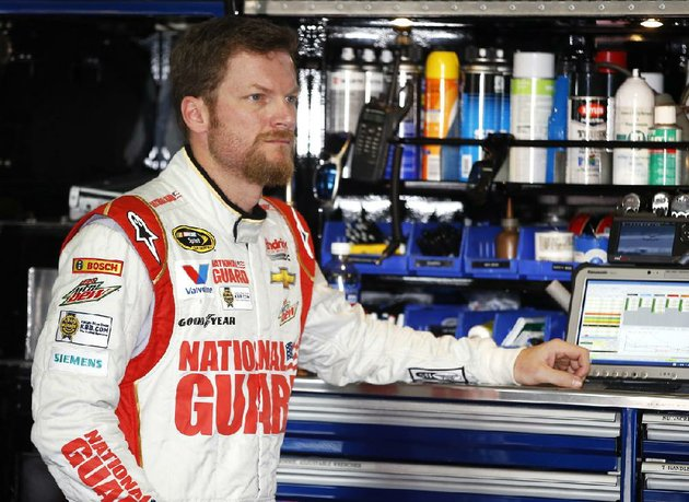 dale-earnhardt-jr-waits-in-the-garage-stall-as-his-car-is-adjusted-during-a-practice-session-for-sundays-nascar-sprint-cup-series-auto-race-at-pocono-raceway-friday-aug-1-2014-in-long-pond-pa-ap-photomatt-slocum