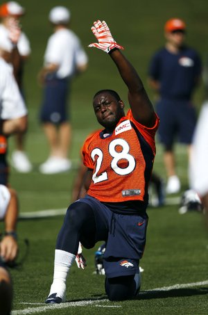 Denver Broncos'  Montee Ball stretches during the first day of NFL football training camp on Thursday, July 24, 2014, in Englewood, Colo. (AP Photo/Jack Dempsey)