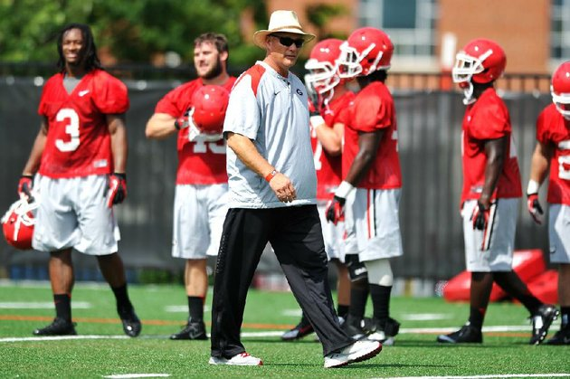 corrects-name-of-photographer-in-caption-georgia-coach-mark-richt-watches-his-players-during-ncaa-college-football-practice-friday-aug-1-2014-in-athens-ga-ap-photoathens-banner-herald-aj-reynolds