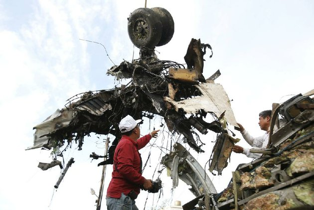emergency-workers-remove-the-wreckage-of-a-transasia-airways-flight-after-last-months-crash-in-taiwan-some-trouble-spots-in-air-travel-safety-are-in-areas-where-such-travel-is-growing-the-fastest