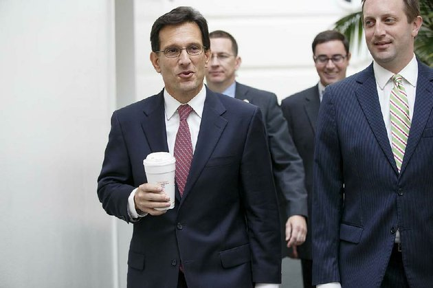 house-majority-leader-eric-cantor-of-va-left-arrives-for-a-house-republican-strategy-session-on-capitol-hill-in-washington-tuesday-july-29-2014-as-a-result-of-his-defeat-in-the-virginia-primary-cantor-will-relinquish-his-leadership-post-at-the-end-of-the-week-ap-photoj-scott-applewhite