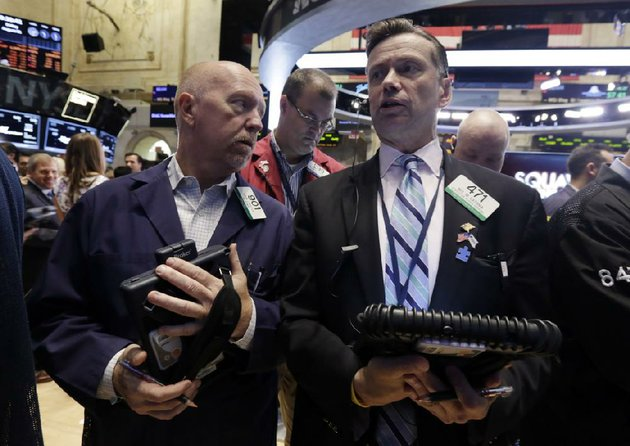 trader-john-doyle-left-and-neil-catania-confer-on-the-floor-of-the-new-york-stock-exchange-friday-aug-1-2014-us-markets-steadied-on-friday-a-day-after-a-major-sell-off-investors-focused-on-a-relatively-strong-jobs-report-which-showed-the-us-economy-created-209000-jobs-in-july-the-sixth-straight-month-of-job-growth-above-200000-ap-photorichard-drew