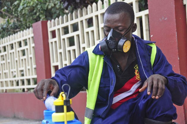 an-employee-of-the-monrovia-city-corporation-mixes-disinfectant-before-spraying-it-on-the-streets-in-a-bid-to-prevent-the-spread-of-the-deadly-ebola-virus-in-the-city-of-monrovia-liberia-friday-aug-1-2014-us-health-officials-warned-americans-not-to-travel-to-the-three-west-african-countries-hit-by-the-worst-recorded-ebola-outbreak-in-history-the-travel-advisory-issued-thursday-applies-to-nonessential-travel-to-guinea-liberia-and-sierra-leone-where-the-deadly-disease-has-killed-more-than-700-people-this-year-ap-photoabbas-dulleh