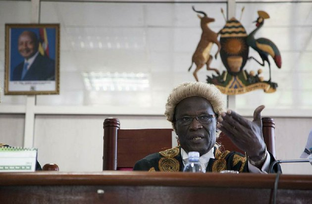 a-photo-of-ugandas-president-hangs-on-the-wall-left-as-judge-stephen-kavuma-reads-the-verdict-at-ugandas-constitutional-court-friday-aug1-2014-a-ugandan-court-has-invalidated-an-anti-gay-bill-signed-into-law-earlier-this-year-saying-it-was-illegally-passed-and-is-therefore-unconstitutional-the-panel-of-five-judges-on-the-east-african-countrys-constitutional-court-said-the-speaker-of-parliament-acted-illegally-when-she-went-ahead-to-allow-a-vote-on-the-measure-despite-at-least-three-objections-over-lack-of-quorum-ap-photorebecca-vassie