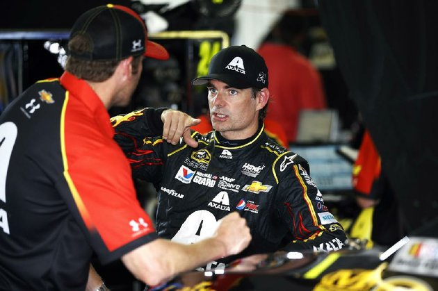 jeff-gordon-right-talks-with-a-crew-member-after-a-practice-session-for-sundays-nascar-sprint-cup-series-auto-race-at-pocono-raceway-saturday-aug-2-2014-in-long-pond-pa-ap-photomatt-slocum