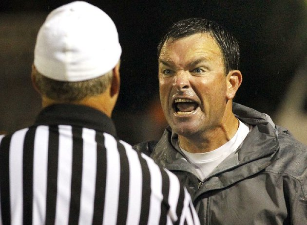 arkansas-democrat-gazette-benjamin-krain-91412-north-little-rock-coach-brad-bolding-argues-with-an-official-during-a-game-against-pine-bluff-coached-by-his-brother-bobby-bolding-on-friday-night