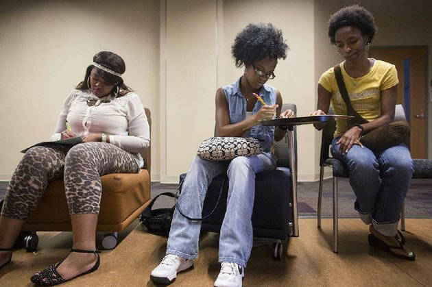 countess-jenkins-from-left-leah-akins-and-natasha-wilbon-do-writing-exercises-wednesday-under-the-instruction-of-harold-brown-during-a-session-at-the-dr-charles-w-donaldson-summer-bridge-academy