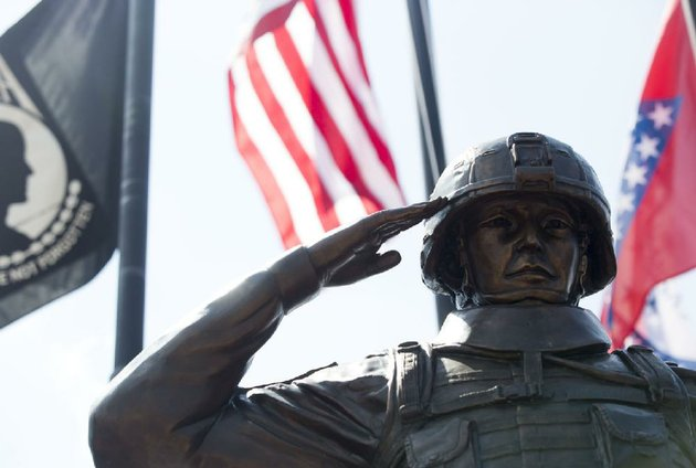 a-statue-of-a-desert-storm-soldier-is-dedicated-saturday-outside-my-friends-place-bar-and-grill-at-military-and-macarthur-drives-in-north-little-rock