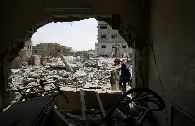 a-palestinian-girl-salvages-belongings-saturday-in-gaza-city-after-her-familys-house-was-destroyed-in-an-overnight-israeli-airstrike