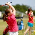 Rogers Heritage freshman Chloe Kordsmeier hits from the driving range during practice on Tuesday, Ju...
