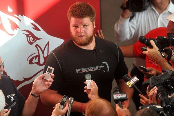arkansas-offensive-lineman-brey-cook-talks-to-reporters-as-razorback-players-report-for-fall-camp-aug-3-2014-at-the-fred-smith-center-on-u-of-a-campus