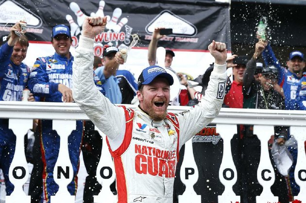 dale-earnhardt-jr-celebrates-in-victory-lane-after-winning-the-nascar-sprint-cup-series-auto-race-at-pocono-raceway-sunday-aug-3-2014-in-long-pond-pa-ap-photomatt-slocum