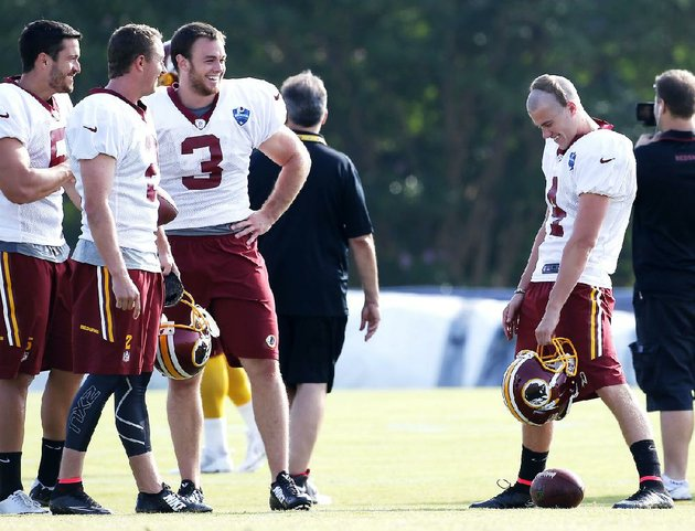 washington-redskins-punters-and-kickers-blake-clingan-left-kai-forbath-second-from-left-robert-malone-third-from-left-and-zach-hocker-right-smile-during-practice-at-the-redskins-training-center-in-richmond-va-thursday-july-31-2014-ap-photorichmond-times-dispatchmark-gormus