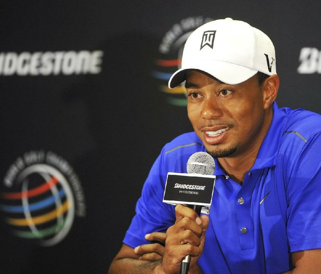 file-in-this-aug-1-2012-file-photo-tiger-woods-answers-questions-during-a-news-conference-at-the-bridgestone-invitational-golf-tournament-at-firestone-country-club-in-akron-ohio-woods-has-eight-wins-at-firestone-one-more-than-matt-kuchar-has-won-on-the-pga-tour-in-15-appearances-he-has-made-1106-million-which-is-roughly-the-same-as-tom-watson-has-made-in-four-decades-on-the-pga-tour-ap-photophil-long-file