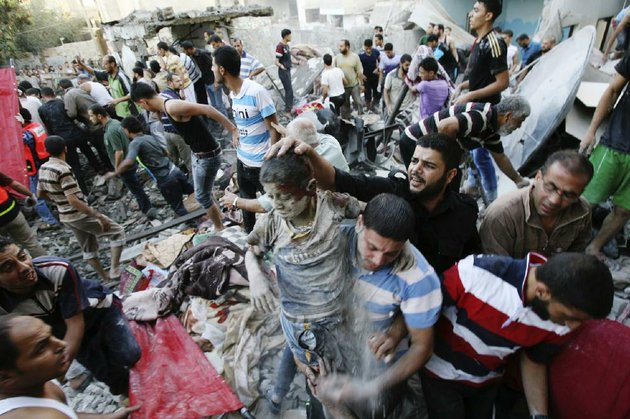 palestinians-evacuate-a-survivor-of-an-israeli-air-strike-that-hit-the-al-ghoul-family-building-in-rafah-southern-gaza-strip-sunday-aug-3-2014-at-least-40-people-were-inside-the-al-ghoul-family-building-in-rafah-camp-when-it-was-targeted-by-israeli-jet-fighters-according-to-the-red-crescent-and-gaza-health-official-ashraf-al-kidra-many-have-been-confirmed-dead-and-over-two-dozen-have-been-wounded-ap-photoeyad-baba