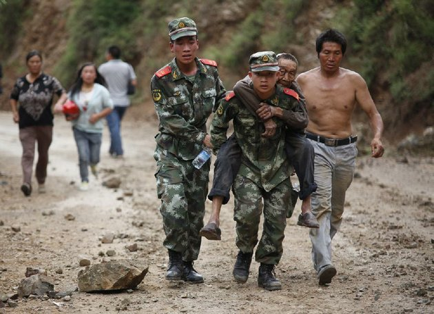 in-this-photo-released-by-chinas-xinhua-news-agency-rescuers-transport-injured-people-after-an-earthquake-in-zhaotong-city-in-the-densely-populated-ludian-county-in-southwest-chinas-yunnan-province-sunday-aug-3-2014-the-strong-earthquake-in-southern-chinas-yunnan-province-toppled-thousands-of-homes-on-sunday-killing-at-least-175-people-and-injuring-more-than-1400-according-to-chinas-official-xinhua-news-agency-ap-photo-xinhua-zhang-guangyu-no-sales