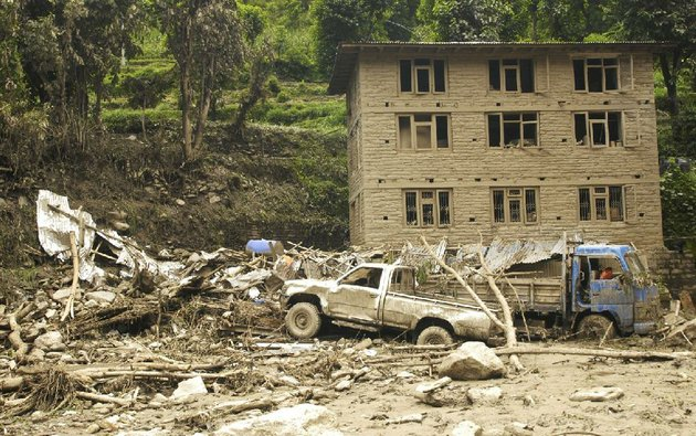 damaged-vehicles-lie-among-the-debris-after-a-massive-landslide-in-village-mankha-about-120-kilometers-75-miles-east-of-katmandu-nepal-sunday-aug3-2014-nepalese-officials-say-there-is-no-chance-of-finding-any-of-the-more-than-150-people-who-are-believed-to-have-been-buried-by-the-early-saturday-landslide-in-northern-nepal-ap-photoarpan-shrestha