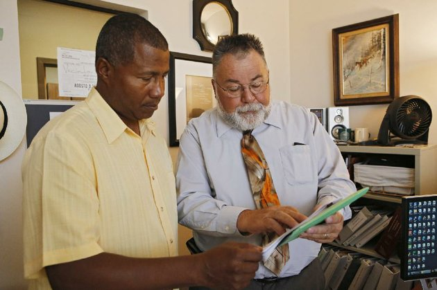 in-this-july-8-2014-photo-william-kistler-right-goes-over-a-clients-information-with-support-specialist-ronald-smith-at-kistlers-office-in-denver-sixty-three-year-old-kistler-views-retirement-like-someone-tied-to-the-tracks-watching-a-train-coming-its-looming-its-threatening-and-theres-little-he-can-dothere-is-not-enough-to-retire-with-said-kistler-a-golden-colorado-resident-who-said-he-is-unable-to-build-up-a-nest-egg-for-his-wife-with-his-modest-salary-helping-seniors-navigate-benefits-its-completely-frightening-to-tell-you-the-truth-and-i-like-a-lot-of-people-try-not-to-think-about-it-too-much-which-is-actually-a-problemap-photoed-andrieski