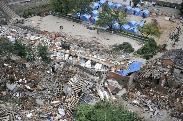 this-photo-released-by-chinas-xinhua-news-agency-shows-the-quake-hit-longtoushan-town-of-ludian-county-in-zhaotong-city-southwest-chinas-yunnan-province-on-monday-aug-4-2014-rescuers-dug-through-shattered-homes-monday-looking-for-survivors-of-the-strong-earthquake-in-southern-chinas-yunnan-province-that-toppled-thousands-of-homes-on-sunday-killing-hundreds-and-injuring-more-than-a-thousand-people