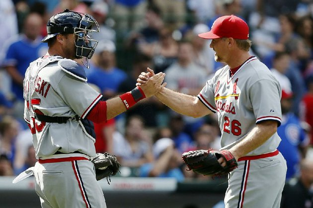 st-louis-cardinals-catcher-aj-pierzynski-and-relief-pitcher-trevor-rosenthal-celebrate-after-defeating-the-chicago-cubs-in-a-baseball-game-on-sunday-july-27-2014-in-chicago-the-st-louis-cardinals-won-1-0-ap-photoandrew-a-nelles