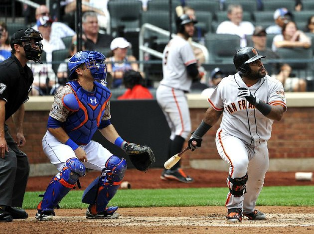 new-york-mets-catcher-travis-darnaud-and-san-francisco-giants-third-baseman-pablo-sandoval-watch-sandovals-two-run-double-off-of-mets-starting-pitcher-dillon-gee-in-the-third-inning-of-a-baseball-game-at-citi-field-on-monday-aug-4-2014-in-new-york-ap-photokathy-kmonicek