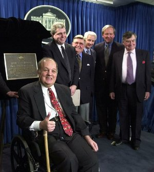 FILE - This Feb. 11, 2000 file photo shows former White House press secretary for President Reagan James Brady, left, in  a group photo following a dedication ceremony for the new James S. Brady Press Briefing Room at the White House in Washington. From left are, Brady, presidential press secretaries Joe Lockhart (Clinton), Jerald terHorst (Ford), Larry Speakes (Reagan), Mike McCurry (Clinton) and Pierre Salinger (Kennedy).  A Brady family spokeswoman says Brady has died at 73. (AP Photo/Susan Walsh/File)