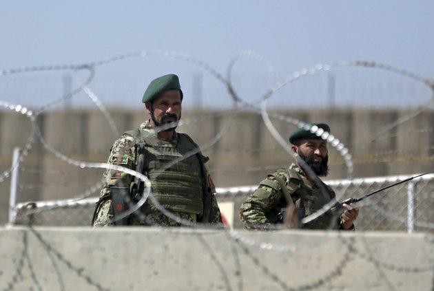 afghanistan-national-army-soldiers-stand-guard-at-a-gate-of-camp-qargha-west-of-kabul-afghanistan-tuesday-aug-5-2014-a-man-dressed-in-an-afghan-army-uniform-opened-fire-tuesday-on-foreign-troops-at-a-military-base-causing-casualties-an-afghan-military-spokesman-said-in-a-statement-nato-said-it-was-investigating-an-incident-involving-both-afghan-and-international-troops-at-camp-qargha-which-trains-officers-for-the-countrys-army