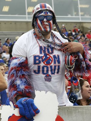 "Buffalo Bills fan Jacob Gauda shows off his ""No Bon Jovi"" shirt during Pro Football Hall of Fame enshrinement ceremonies Saturday in Canton, Ohio. Gauda and most Bills fans don't believe Jon Bon Jovi and a Toronto-based group will keep the NFL team in Buffalo."