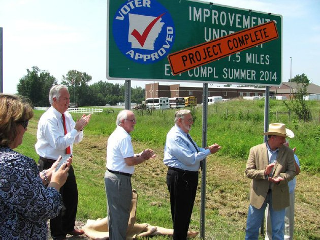 officials-unveil-a-sign-tuesday-proclaiming-the-completion-of-the-interstate-540-reconstruction-in-fort-smith-and-van-buren-the-78-million-contract-was-the-largest-in-arkansas-highway-and-transportation-department-history-from-left-are-fort-smith-city-administrator-ray-gosack-arkansas-highway-commissioner-dick-trammel-fort-smith-mayor-sandy-sanders-and-9th-district-state-sen-bruce-holland-r-greenwood