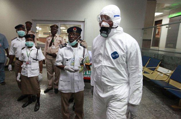 in-this-monday-aug-4-2014-file-photo-nigerian-health-officials-wait-to-screen-passengers-at-the-arrival-hall-of-murtala-muhammed-international-airport-in-lagos-nigeria-a-nigerian-nurse-who-treated-a-man-with-ebola-is-now-dead-and-five-others-are-sick-with-one-of-the-worlds-most-virulent-diseases-authorities-said-wednesday