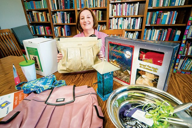 diana-byrd-director-of-conway-cradle-care-is-shown-with-a-group-of-items-that-will-be-part-of-the-upcoming-auction-and-fashion-show