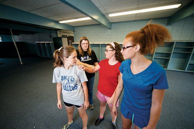 above-ladonna-gibson-artistic-director-of-the-bald-knob-fine-arts-council-back-instructs-mattea-smithson-from-left-brooke-manley-and-sarah-gibson-during-a-dance-class-in-bald-knob